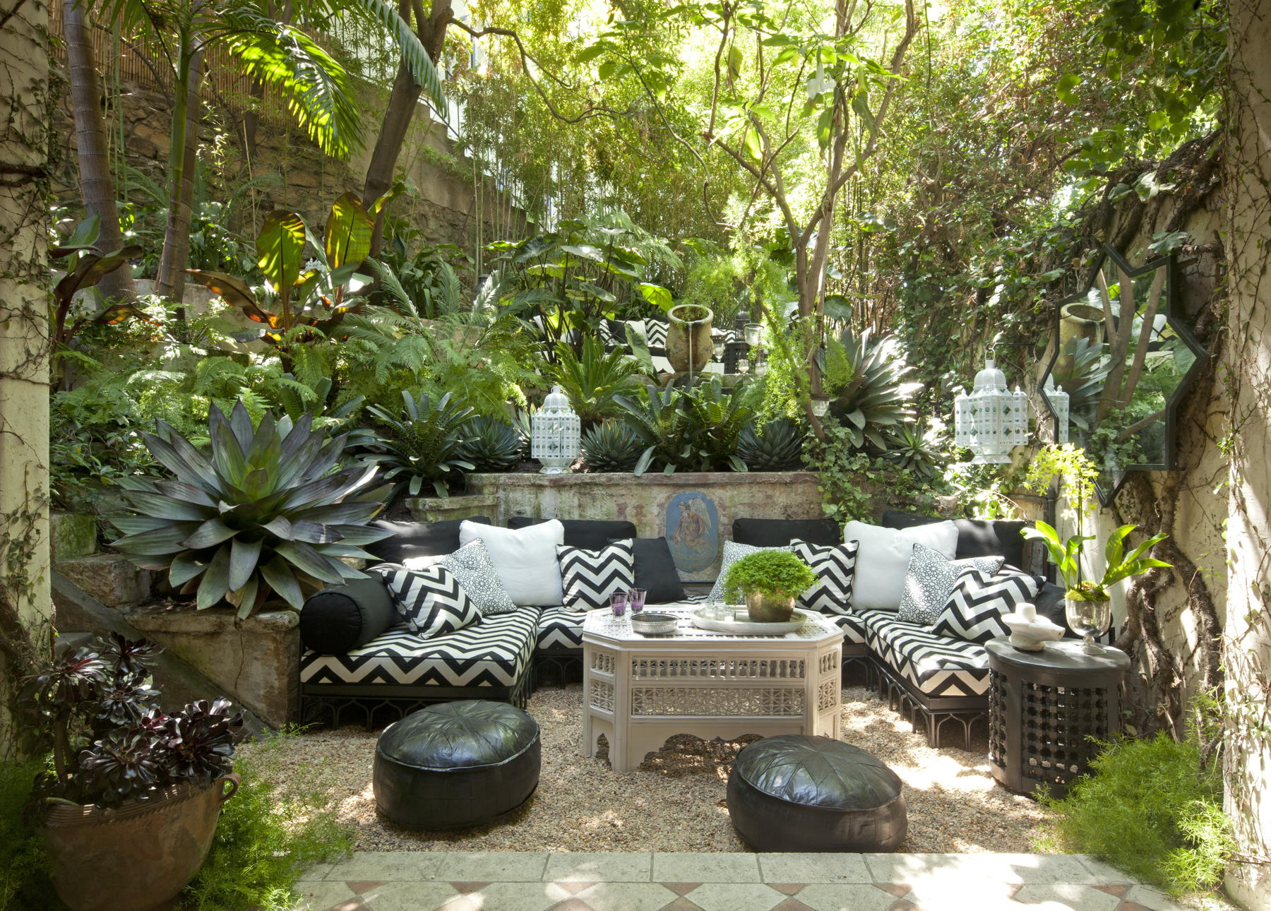 Garden seating at Villa Swanson in Hollywood, designed by Martyn Lawrence Bullard